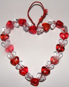Beaded heart ornament - Bend your wire into a simple shape. Thread the beads onto the wire. Twist the ends together. Cut the wire so you are left with two over hanging pieces of wire. Twist the ends of these together to form a loop to hang.