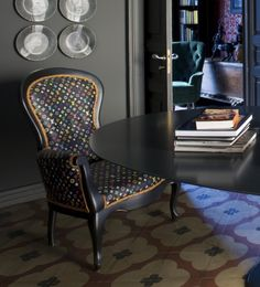 this louis vuitton-upholstered armchair was found at a sicilian flea market. try to knock that off in a chinese factory. (elle decor, dec 2012)