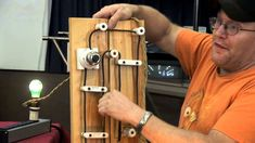 """In the time of Thomas Edison we used pocelain insulators """"knob and tube"""" system. Rick DeLair shows us a working model with cleats, tubes and a 100+ year old ..."""
