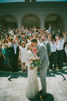 see THIS is a great wedding photo! The couple should be in front of their family, they are the focal point!