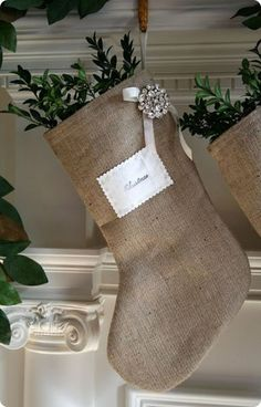 Burlap Stockings...gathering ideas for DIY stockings this year...I like this one! Especially with the boxwood sprigs until Christmas morning!