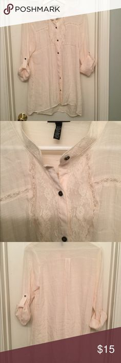 Blouse cream color Beautiful button up blouse with lace in front.  Worn only once.  Has small removable hoops for a thin belt (not included) - shown in photo. Tops Blouses