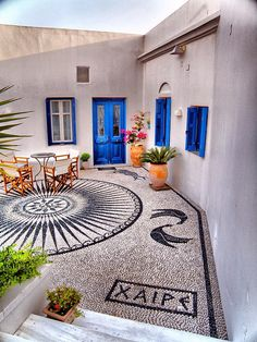 Beautiful mosaic on a house in Milos
