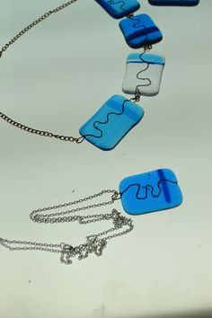 Water based design. Can you see the seaweed? Fused glass jewellery.