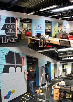 Creative employees transform their office with 'Star Wars' murals made of 3,597 Post-Its.