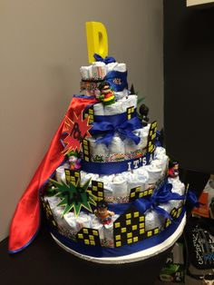 Superhero Batman Superman Justice League Diaper Cake (Letter D for Daniel). Complete with Action Words, Mask & Cape and foam buildings that are supposed to represent Gotham City. And 6 Fisher Price Superheroes/ Villians.