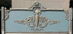 Beautiful ornate antique headboard painted with French Blue,  Creamy Linen and Gold Shimmer Metalique by Farmhouse Paint.   Farmhousepaint.com
