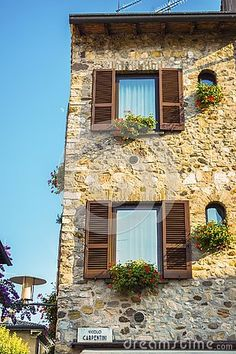 Photo about Italian street beautiful house facade with blinds.The photography is taken in the town of Sirmione on the shores of lake Garda. Image of photography, lake, modern - 145557279 Italian Street, Lake Garda, Facade House, Free Stock Photos, Beautiful Homes, Blinds, Cabin, House Styles, Modern
