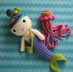 Mermaid Nursery Decor: Crocheted Mermaid Doll with Jellyfish Friend. i wish the mermaid's hair was a natural hair color, and i love the jelly fish