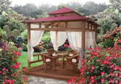 gazebo decorating ideas, curtains, outdoor furniture and flower beds