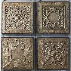 """Embossed metal is lightly washed with brown stain to capture the look of antiquity. Metal frame; distressed, brown painted finish. Set of 4, as shown; 17 3/4"""" sq. x 1 1/4"""" thick."""