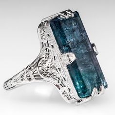 Vintage 12 Carat Bi-Colored Tourmaline Filigree Cocktail Ring 18K White Gold centered with a large bi-colored tourmaline stone 18.3x8.3mm