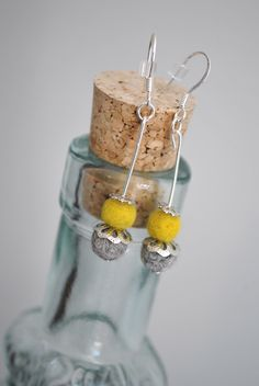Beautifully paired yellow and gray needle felted earrings.   Check my etsy page for ordering: https://www.etsy.com/shop/ArtByBarks