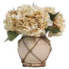 """Add an organic touch to your entryway console table or living room mantel with this faux hydrangea arrangement, nestled in a jute-trimmed ceramic vase.  Product: Faux hydrangea arrangementConstruction Material: Silk, plastic, jute and ceramicColor: Cream, green and naturalFeatures:  HandmadeIncludes faux hydrangeasDimensions: 10.5"""" H x 12"""" W x 13"""" D"""