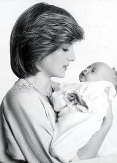 The Princess of Wales holding her newborn son, Prince William in 1982