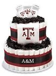 """Texas A Aggies Diaper Cake - The perfect baby shower gift for the collegiate sports fan! These creations are made from layers of diapers, stacked to look like a cake and filled with licensed collegiate baby products (or as we like to call them, """"ingredients""""). The standard diaper cake includes two layers of diapers (40-45), a team t-shirt, knit cap and booties.     Cakes may vary in color or """"ingredients"""" with available inventory."""