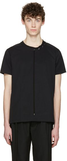 Short sleeve heavyweight cotton jersey t-shirt in black. Rib knit crewneck collar. Patch pocket at chest featuring bonded text  and d-ring hardware. Silver-tone hardware. Tonal stitching.