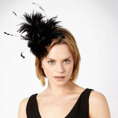 Hmm....not so sure about this one! Black towering feather headband