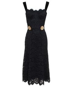 Dolce & Gabbana's new-season black lace dress is modern and elegant, featuring sleek black velvet straps and tie belt, and a sexy sculptured bustier-style top. The piece is cut to a mid-length silhouette and is accented with two gold-tone floral brooches at the waist for added allure.<br>*Please note, that we are unable to deliver Dolce & Gabbana to Hong Kong, China, Singapore, Malaysia, Thailand, Korea, Taiwan and Japan.