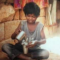 Child in the slums of Bangalore.  Bulding Blocks India opens their early learning centers so they might have a head start on life!