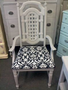Vintage painted gray arm chair with black and white fabric. Coordinates with dresser and side table $89.00