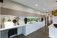 Kitchen with study nook in the Milan by Stylemaster Homes