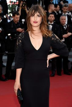 "Jeanne Damas in a Gucci one of kind black silk embroidered sleeve gown to the world restoration premiere of ""Rocco and His Brothers"" at the 68th Annual Cannes Film Festival."