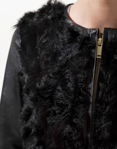 Leather jacket with fur.