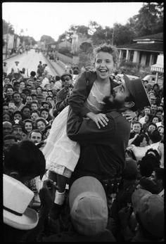 Castro lifts a young admirer, Cuba 1959 by Burt Glinn