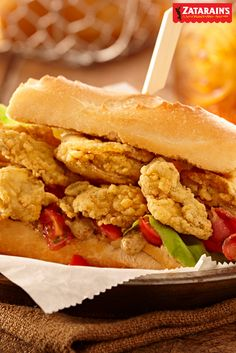 This version of a classic new orleans dish, oyster po' boy includes crisp applewood smoked bacon and a tomato salad. This fried oyster recipe is sure to be a hit at your Mardi Gras celebration or game day party.