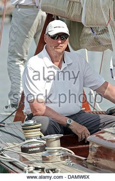 King Harald V of Norway sits at the helm of his boat Sira at the Quellental marina in Gluecksburg, Germany, 29 June 2011. The Norwegian monarch is taking part in the 'Rolex Baltic Week' sailing regatta and this year's 8-meter class world championships in the 73 year old, family-owned yacht.  Photo: Markus Scholz - Stock Image