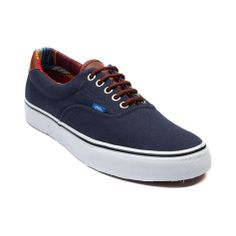 Shop for Vans Era 59 Skate Shoe in Navy Multi at Journeys Shoes. Shop today for the hottest brands in mens shoes and womens shoes at Journeys.com.Classic vulcanized shoe from Vans thats perfect for skating or everyday wear. This Vans Era 59 features a canvas upper with leather heel contrast, padded collar with multicolored stripes, round lace closure with metal eyelets, and vulcanized rubber outsole with waffle tread.