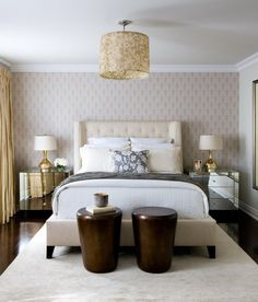 Toronto Interior Design Group: Contemporary ivory and gold bedroom with wallpaper accent wall, yellow silk drapes and drum light