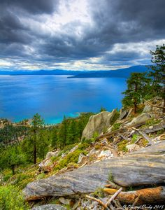 The View across Lake Tahoe from the east rim, in Nevada, toward California side, from the Flume Trail, 1200 feet above lake level. An unseasonable cold front (for August) brought thunderstorms and perfect mountain biking weather to the Sierra Nevada mountains.  View Larger