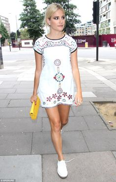 Pixie Lott: embroidered white mini, white lace-ups. Nice yoke detailing; more embroidery helps define silhouette
