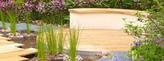 Round decking with curved bench // Nigel Dunnett, Chelsea Flower Show 2013