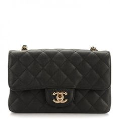 This is an authentic CHANEL Caviar Quilted Rectangular Mini Flap in Black. This chic petite shoulder bag is crafted of diamond quilted luxurious shiny caviar leather in black.