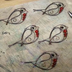 A flock of red robins on the craft bench today.