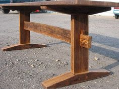 A trestle table with some lighter Shaker type stylings. It is much thinner and finer than much of our work but it still uses some great old reclaimed wood.