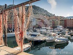 View to the port of Camogli, Italy through a fishnet