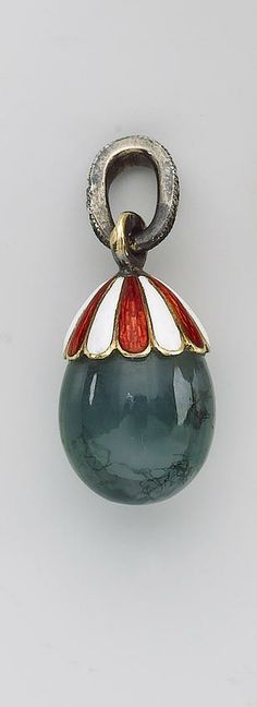 A Fabergé gold and enamel-mounted moss agate miniature pendant Easter egg, workmaster Fedor Afanasiev, St. Petersburg, late 19th century, the mount with alternating panels of red and white enamel, the suspension loop set with a row of diamonds.