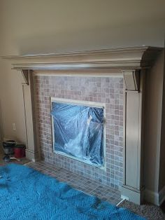 Do it yourself tutorial on how to retile a fireplace with new paint fireplace tile a diy makeover solutioingenieria Choice Image