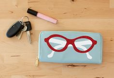 Sunglasses Wallet made with Cricut red glitter iron-on. Make It Now with the Cricut Explore in Cricut Design Space.