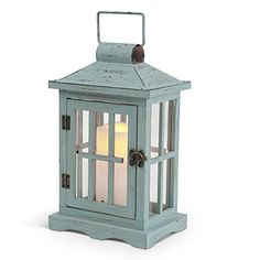 """Gerson Everlasting Glow 42761 Wood Lantern with Metal Roof and 3 by 4"""" Flameless LED Resin Candle, 7.4 by 12"""", Light Blue/Green Gerson http://www.amazon.com/dp/B00Y938I9O/ref=cm_sw_r_pi_dp_z6Kxwb0C9BNPT"""