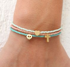 Tiny Charm Bracelets - Beaded Bracelets with charm - Pastel Bracelets - Tiny Skull Bracelet - Tiny Heart - Tiny Cross - Tiny Star This listing is for ONE bracelet!!Chose your favorite colour and charm and make the cutest bracelet ever!! You can wear them together or stack them with