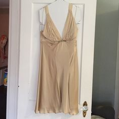 Champagne silk halter dress Gorgeous and only worn twice!  Beautiful gold silver bead detail at the bust!  This dress is perfect for any season! White House Black Market Dresses Prom