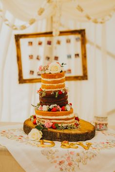 Make sure to decorate your naked cake with all sorts of yummy berries and pretty flowers. Photo by Benjamin Stuart Photography #weddingphotography #weddingcake #nakedcake #3tiercake #festivalwedding #cake #weddingday