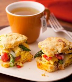 Asparagus Scramble Biscuits: This recipe starts with square bacon-flecked cornmeal biscuits you can make ahead. In the morning, scramble the egg-veggie mixture, fill the biscuits, and bake to heat and melt the cheese.