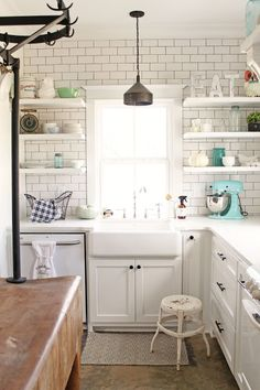 This kitchen - seriously - INCREDIBLE. The white subway tile all the way up, open shelving...so dreamy <3