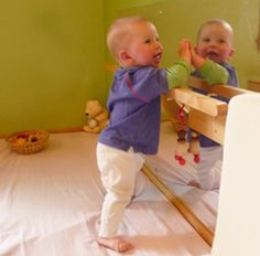 pulling up at the bar and mirror - Montessori play area